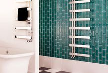 Bisque Alban Radiator / This stainless steel towel radiator looks fabulous in contemporary interiors. Great for wet rooms and family bathrooms alike, the cantilevered rails allow space for the plumpest of towels and the radiator can be installed with the rails to the right or left. Available with dual fuel for summer use and as an electric-only option.