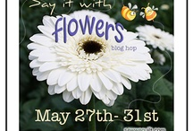 Say it with Flowers blog hop / May seems befitting to create floral quilted pieces...Carol from just let me quilt, will be cheering away on this one. She has become a reliable, funny, creative and a thorn in my side when it comes to competition...shhhh did I just say that lol.  Join us will you...you will be in a garden of lovely creators... / by Mdm Samm ...