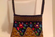 Vintage Embroidered Bags / The embroidery of these bags were made in the 70s, by my grandmother. In that period, these embroideries was used for tablecloths, curtains, carpets. Years passed, fashion has changed. Discovering these embroideries I thought to reuse them to create these bags.