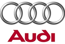 """Audi / Audi AG designs, engineers, manufactures and distributes automobiles and motorcycles. The company name is based on the surname of the founder, August Horch. """"Horch"""", meaning """"listen"""", becomes """"Audi"""" when translated into Latin. The four rings of the Audi logo each represent one of four car companies that banded together to create the company. Audi's slogan is Vorsprung durch Technik, meaning """"Advancement through Technology""""."""