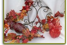Fall Leaves, Garland & Leaf Clusters / Our Fall Leaves and Fall Garlands are available Year-Round!   Fall Leaves are one of our #1 requested items. Our Fall Leaves have the best color and quality. They can be sprinkled down the edges of your runner, used around the base of table centerpieces, dropped naturally at the place card table and used at the head table edging. Each bag contains a variety of shades and sizes.