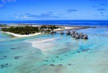 """DISCOVER: Tikehau / Known as """"The Pink Sand Island,"""" this oval-shaped atoll is an important supplier of fresh fish and copra. Tikehau boasts exotic pink sand beaches and an abundance of sea life that make it a must for scuba divers."""
