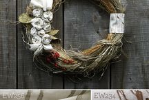 Holiday Wreath Inspired by Natural Materials / A Swedish inspired wreath hand-made of Arrowroot — one of many natural fibers used in our handwoven products. Accented with decorative hand-twisted rosettes of our natural fabric.