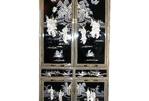 Armoires with Asian Influences / Oriental armoire in shiny black Chinese lacquer with hand carved mother of pearl inlays and hand painting at Import direct pricing! This breath taking 4-door Armoire has 3 shelves behind the top 2 doors and two felt lined drawers. This cabinet measures 42 by 16 by 78 inches high and is solid wood construction it can be used as a bar, book case, entertainment center. Purchase now; supplies are limited on quality hand made imports.