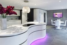 Portfolio | Luxury contemporary designer kitchen / A beautiful curved kitchen with curved island with an eight shaped worktop with italian leather padded wall and Miele appliances throughout.