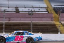 Event Day: At the Racetrack - #GETYOURMOTORRUNNING / The goal: Give our clients a high-octane experience – highlighted with a fast-paced & competitive stock car race that had the adrenaline & excitement pumping!
