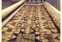 Totally Patched Long Arm / A board showing some of the many Long Arm Quilts we have completed.
