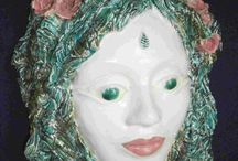 Ceramic Faces / I love to make masks and faces with Goddess like features. This mask was made from earthernware clay and has been fired and is ready to hang on the wall. Hand made by Tanya Hollatz from New Zealand.