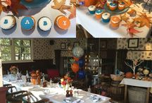 Autumnal baby shower in Greenwich London. / A beautiful autumnal day! We styled this venue for a client, we chose a dark blue to compliment the orange which was a nod to the date of the shower - Halloween!  Autumnal coloured flowers with sprigs of blue in pumpkins and jam jars for the table and a side table with A pumpkin baby, a wishing tree which we hung baby socks from with good will notes inside for mummy to be, along with yummy cakes, jelly babies and popcorn. www.mrsjonestea.co.uk