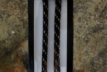 Black and gold shoelace rope with gold tips