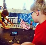 Stop Motion Films (IBuild-IFilm week) / Kids build projects that become creative play, a kind of storytelling. They then make backdrops (sets) and more props, we give them iPods and their creations become stop motion animation films. Children bring home their films and projects at week's end.