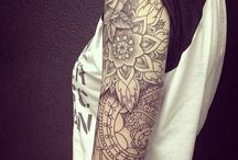 "Tattoo Inspo / Inspiration for next tattoo concepts: 1] Small, simple finger tattoo with ""Daley"" 2] Small, clean roman numerals tattoo with "" XXI-V "" 3] Intricate forearm tattoo sleeve. Feminine. Elegant. Geometric. Working in existing paw tattoo. Incorporating the theme of Abu. Jungle if possible. Mandala. Egyptian. Black."