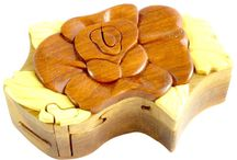 Timber-Treasures rose puzzle box / These cleverly designed puzzle boxes are a secure place to store small valuables, with their secret locking mechanism. Hand crafted in the style of a rose, the intriguing locking sequence keeps secrets secret. It has parquetry lid decoration and a flock lined interior. External dimensions - 18 x 10 x 5.5 cms* Internal dimensions - 8.5 x 4 x 1.5 cms* *handmade disclaimer