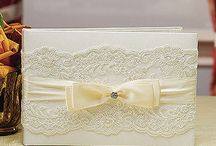 Wedding Guest Books / From contemporary to traditional, Center Of Attention has a great selection of wedding guest books that are sure to please! You will love the array of themes, styles and adornments that make our selection of guest books able to meet any need. With classic elegance, our beautiful books are the perfect way of recording your guests' personal notes and special wishes for you to treasure for years to come. With so many styles and colors available you're sure to find the perfect one for your wedding.