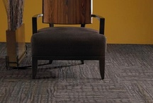 Carpet Floors / Nothing measures up to the sound absorbency and softness of carpet.  With some of our carpet selections you could fall out of bed and not even realize it.  While broadloom is still the carpet of choice in residential applications, the introduction of carpet tiles was a great innovation for commercial uses.  Transporting carpet in freight elevators is a lot less cumbersome than it used to be.