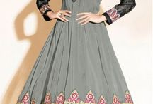 couturemasala / A Grey Georgette anarkali with black sleeves and embroidery on york, shoulders and hemline.The suit set comes with 3 pieces, an unstitched salwaar, a semi stitched kurti/anarkali and a fully finished dupatta.