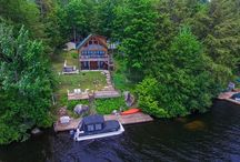 178 Minnowbrook Lane, Old Forge NY / This the quintessential lake front adirondack home. There are 3 bedrooms and 2 bathrooms with over 1300 square feet of space. The cathedral ceilings are accentuated by floor to ceiling windows which let in the sunlight and amazing views of the lake. There are gleaming hardwoods throughout the open floor plan. The living room fireplace will keep you cozy when you come in off the water.