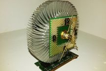 Heat Sink Computer Clocks / These original clocks are made from heat sinks and CPU chips mounted on a stick of RAM.