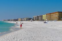Okaloosa Island Living in Fort Walton Beach FL / Fort Walton Beach is a popular seaside community in Northwest Florida. Okaloosa Island is a great vacation destination and where many folks choose to live in one of the beach condos located here.