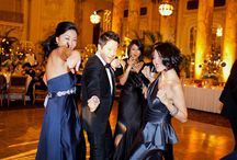 black groom suits and navy bridesmaid