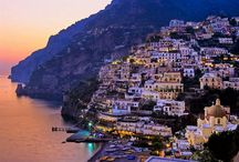 Positano, Italy / Positano is a village and comune on the Amalfi Coast (Costiera Amalfitana), in Campania, Italy. The main part of the city sits in an enclave in the hills leading down to the coast.