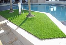 Artificial Grass by the Pool / Thinking of potential materials with which to surround and ornament your pool? Consider artificial grass: it brings more warmth and functionality than the typical concrete pool deck. And as opposed to real grass, with synthetic grass you no longer have to fret about grass clippings getting into the pool! What more can you ask for?