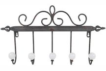 Wall Hooks and Coat Hooks / Wall hooks come in a range of styles and sizes that make perfect sense in any foyer or entry way. By having decorative wall hooks in your home, you can easily add style to a small space and maximize or create storage. Decorative wall hooks attached to rustic wooden shelves or wall cupboards add multiple dimensions of storage while a simplistic rack that mounts flush to the wall with a few protruding hooks can serve as a simple coat rack for jackets, hats, and other types of outerwear.