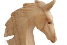 Timber-Treasures Small Horse Head / A beautifully hand carved horse bust made from Persian Lilac wood. Placed where people can appreciate its elegant profile it will be a real focus of attention in the room, and the grain and figure of the Persian Lilac wood it is made from only enhances the great strength and beauty of the subject. Measurements - 9.2 x 15.5 x 3 cm* *handmade disclaimer