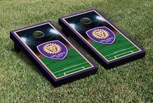 "MLS | GOAL! | Victory Tailgate / Victory Tailgate, Made Loyal's sister company is an officially licensed MLS soccer cornhole game manufacturer and are made proudly in the USA. Each game set comes with two 24""x48"" regulation boards with folding legs, a complete bag set (8 bags), and a FREE string pack to carry the bags."