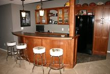 Custom Built Maple Bar / Lower Level build out that included the custom maple bar that was designed and built by our team in our shop. The client was also very hands on throughout the project by installing tile, painting and installing the theater system