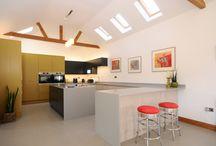 Tri colour Kitchen / Painted Veneer, Handleless Matt Graphite and Timber affect Handleless with Corian worksurfaces. Bosch appliances