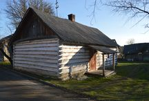 Polish 19th Century Wooden Log Houses / Derelict wooden 18/19th century log cabin and brick built peasant houses in the polish countryside near Zamosc..
