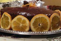 chocolate , blueberry and orange cake