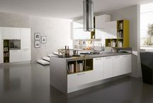 Natura / The excellence of made in Italy design, a high range project that stands for the wealth of chromatic and aesthetic innovations, for the wide modularity and for materials with a strong personality like material aspect, stainless steel, matt and glossy white. Kitchen systems characterized by simplicity and elegance for a refined taste and consistent values for the conceptual design kitchen-living room.