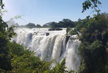 Victoria Falls / There are some places in the world that are absolutely beyond words.  Victoria Falls (on the border dividing Zambia & Zimbabwe) is one of those sites.  People travel 1,000s of miles just to see it.  I've been privilege to visit twice!