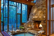 Indoor stone fire place and hot tub.