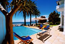 Villa St James / Hovering over False Bay with a 360-degree view of mountain and sea, is the enchanting and luxurious Villa St James, a restored historical National Monument ideal for a lavish seaside holiday, or corporate function in the coastal town of St James, in Cape Town.