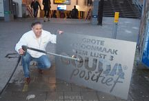 "Campaign Gouda Positief / Positive Gouda is a local political party since 2010. With the municipal elections they wanted to express their political scream through the city. Along with Natuurlijkadverteren.nl they wanted to make themselves heard for a ""political cleaning. The chairman Johan Weeber placed the first reverse graffiti  under the visor of a press photographer of the newspaper."