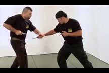 "Tech: Kapap / KAPAP is an acronym for Krav Panim el Panim, translated as ""face to face combat"", is a close quarter battle system of defensive tactics, hand-to-hand combat and self defense.  In the early 1950s the term KAPAP was used interchangeably with the term Krav Maga as elements of the syllabus altered. By the time the 1960s came, the term was used only within certain units who needed more than basic training in Krav Maga such as Unit 216, Sayeret Matkal."
