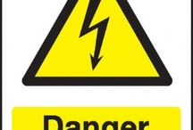 Electrical hazard warning signs / We all need to keep our workplace accident free. Electrical equipment and electrical supplies can provide extreme hazards. To assist business and industry in the UK, The Sign Shed has introduced a range of Electrical hazard warning signs. These electrical warning signs are designed to warn of electrical hazards to physical health for both workers and members of the general public.   The signs feature a triangular shape with a black picture on a yellow background with a black border.