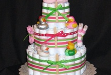 Stuff I Make - Diaper Cakes / My diaper cakes are great for baby shower gifts, christening gifts, or welcome baby home gifts. They come wrapped in clear cellophane and can be shipped anywhere! www.suzannemadeline.etsy.com / by Suzanne Smith Busso