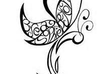Tattoos and Piercings  / by Melanie Brickner