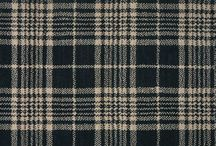 Plaid / This classic pattern is spotted in apparel, accessories and home decor. Plaid is best paired with solid colors and varying textures to balance out the room. Use plaid to accent a room or go bold with tartan or gingham plaid carpeting.