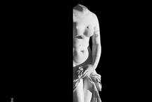 Landolina / Publicity poster for the Syracuse archeological museum that portrays one of its most spectacular works: the Landolina Venus (Venere Anadiomene, 2nd Century A.D.), as though she were emerging from behind the curtain in a darkened theatre or from a sea of foam. Designed by Maria Rosa Castiglione for the Museo Archeologico Regionale Paolo Orsi, Syracuse.