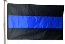 Thin Blue Line Flags / AmericanFlags.com is proud to debut these Thin Blue Line Flags designed to honor and remember fallen law enforcement officers.