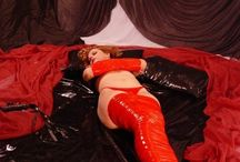Erotic Latex Dreams, Redhead Tightly Bound in Red Bondage Tape on Latex Sheet