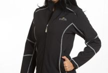 Christine Soft Shell Jacket / Great as outerwear for many sports such as running, horseback riding, skiing – or just a chilly night on the town. Our polyester fabric stretches and tastefully hugs the body as you move, making every activity comfortable as the jacket breathes and simultaneously captures warmth. Beautiful styling with contrasting stitching and zippers will generate compliments nonstop! Pockets include two interior so you always have room to store your devices and other everyday needs.