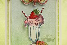 Berry Cafe Collection / Images of playful pals, vintage lemonade stands, budding strawberry blossoms, plump strawberries, buzzing bees, vintage milkshakes and heirloom picket fences. Matching dies to make creating a breeze. A color palette of dandelion yellow, ocean mist blue, brilliant meadow greens, passionate blazing red and vintage pinks are layered in rustic and wonderful papers making this a creative paper oasis that will refresh and inspire you.