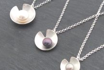 Lily Pearl Jewellery / A beautiful handmade sterling silver lily pad style collection with a freshwater pearl.  Create a unique look with different sizes of lily pad available with different neutral colour choices. This timeless collection is a versatile piece of jewellery and is so easy to wear.  Available with a choice of coloured freshwater pearl, white, pink, silver or peacock.  Please note that the colour and size of pearls can vary slightly due to their nature.