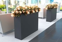 - nevins planters - / Nevins offers versatile lines of metal and fiberglass planters that complement any environment. With a variety of shapes and finish options, Nevins planters offer an upscale elegance to brighten any space.
